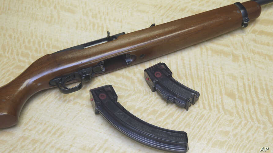FILE - A semi-automatic rifle is displayed with a 25-shot magazine, left, and a 10-shot magazine, right, at a gun store in Elk Grove, Calif., June 27, 2017.
