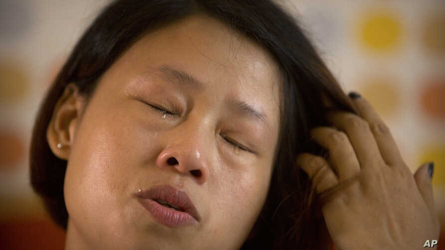 Deng Guilian cries during an interview in her hotel room in Ganzhou in southern China's Jiangxi Province, June 6, 2017. They took her husband, then tried to silence her.
