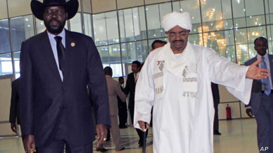 Sudan's President Omar al-Bashir welcomes his South Sudanese counterpart Salva Kiir for his first visit since southern secession to discuss key unresolved issues that have undermined north-south relations, during his arrival at Khartoum Airport, Suda