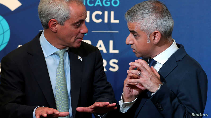 Mayor of London Sadiq Khan (R) speaks with Chicago Mayor Rahm Emanuel at the Chicago Council on Global Affairs in Chicago, Illinois, U.S., September 15, 2016.