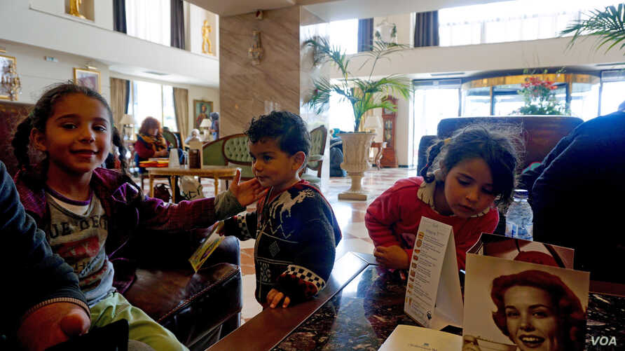 Syrian children at the Mediterranean Palace Hotel enjoying their respite from the hunger, cold and misery of the refugee trail, Thessaloniki, northern Greece, March 6, 2016.