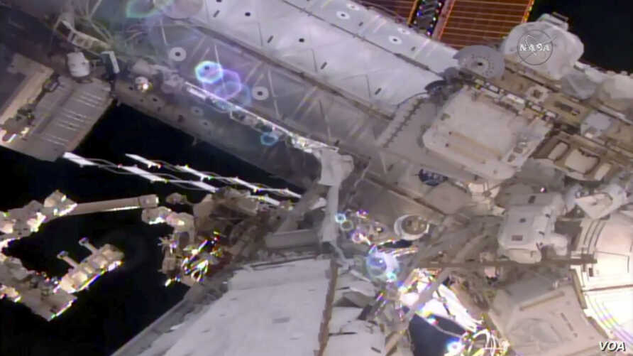 This still image taken from live video provided by NASA shows astronaut Shane Kimbrough, right, works on the International Space Station during a space walk March 24, 2017.