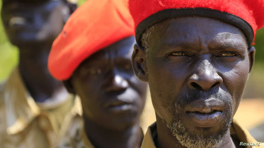 South Sudanese soldiers listen during a briefing at the army general headquarters in Juba, Jan. 8, 2014.