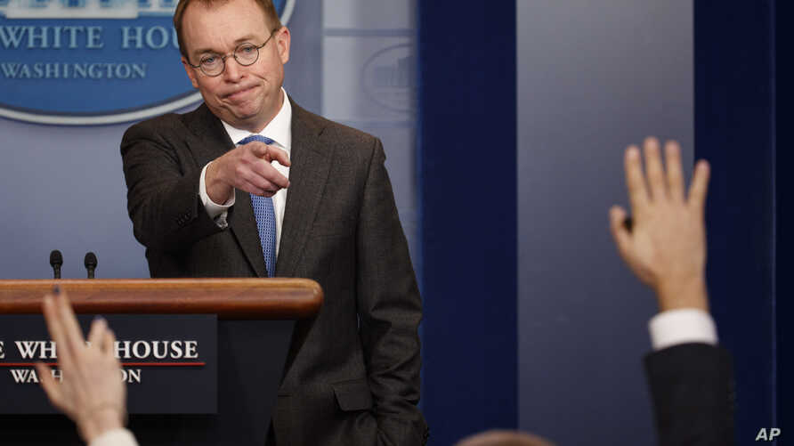 Director of the Office of Management and Budget Mick Mulvaney calls on a reporter during a White House briefing about a possible government shutdown, Jan. 19, 2018, in Washington.