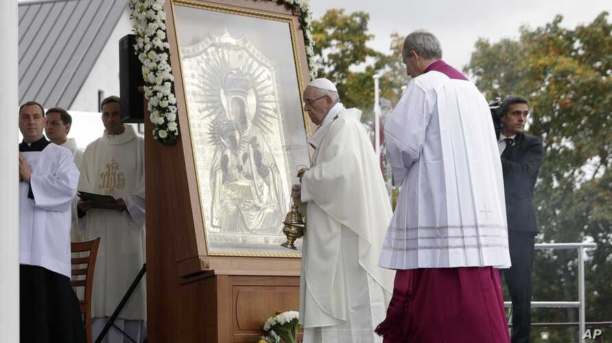 Pope Francis celebrates Mass in the area of the Shrine of the Mother of God, in Aglona, Latvia, Sept. 24, 2018.