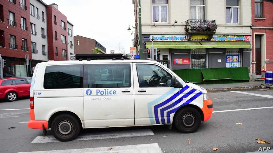 A police van makes its way to arrest people in connection with the deadly attacks in Paris, in Brussels' Molenbeek district, on Nov. 15, 2015.