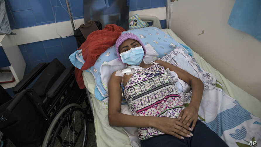 A young woman, who has a tumor in one of her lungs, lies in a bed in the Vargas Public Hospital in Caracas, Venezuela, Feb. 5, 2019.