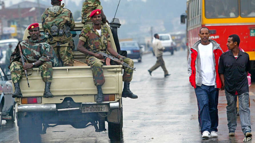 Ethiopia Protests: FILE - In this June 10, 2005 file photo, members of the Ethiopian army patrol the streets of Addis Ababa, Ethiopia, after recent clashes with protesters. Violent weekend clashes between protesters and security forces have claimed t