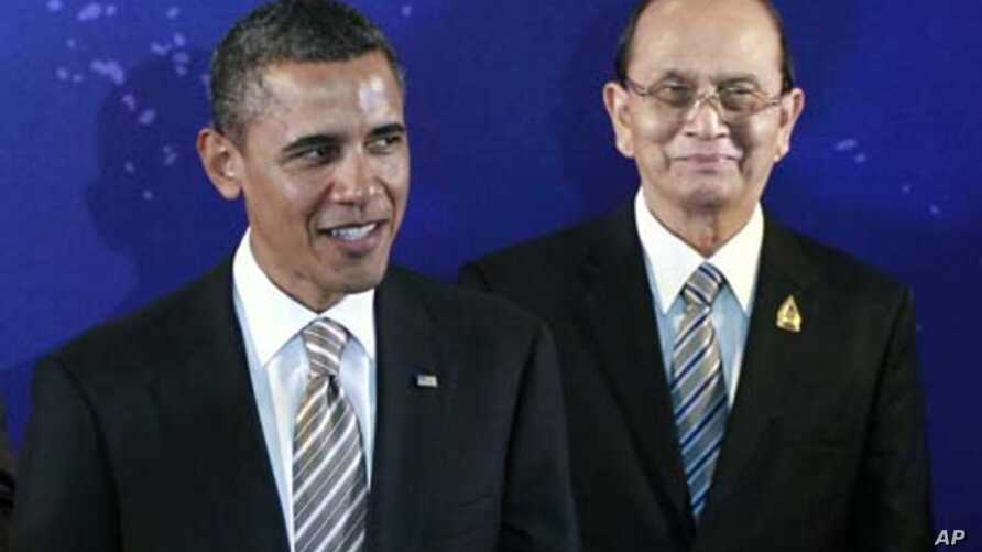 President Barack Obama, left, stands with Myanmar President Thein Sein during a group photo session at the East Asia Summit in Bali, Indonesia, November 19, 2011.