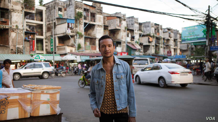Prumsodun Ok stands in the middle of a street in Phnom Penh, Cambodia, July 19, 2016. (Courtesy of Lim Sokchanlina)