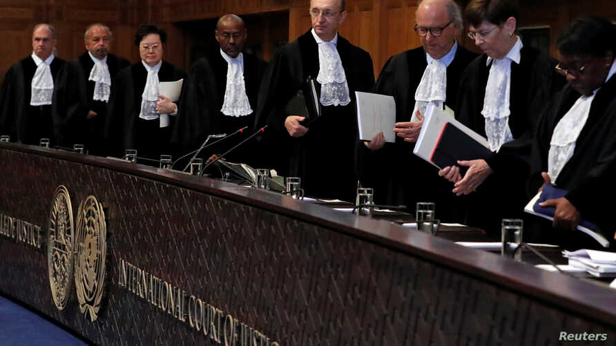 FILE - Judges are seen at the International Court of Justice, the U.N.'s highest court for disputes between states, in The Hague, the Netherlands.