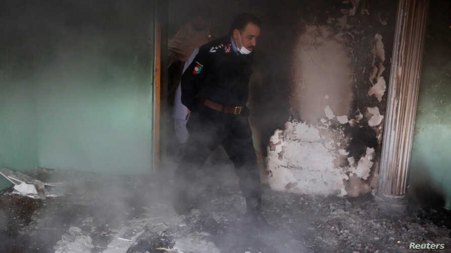 An Afghan police officer inspects the house of an Afghan member of parliament which was attacked by Taliban last night in Kabul, Afghanistan, Dec. 22, 2016.