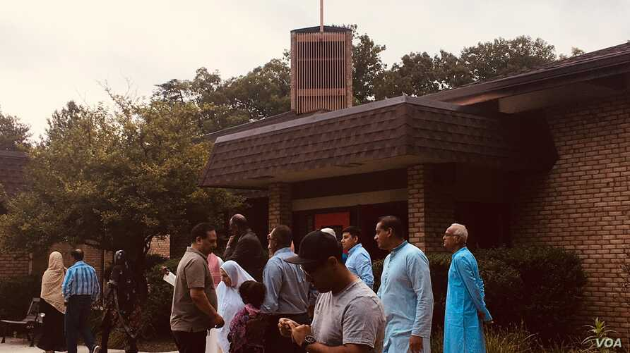 Muslim Americans from different cultural backgrounds perform their Eid prayer at Saint Andrews Church in Burke, Virginia, Aug. 21, 2018.