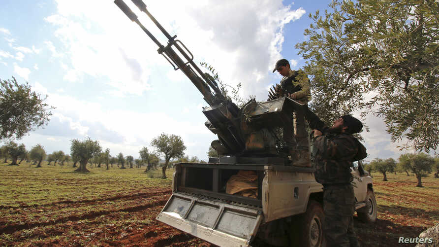 Rebel fighters man an anti-aircraft weapon at the front line against forces loyal to Syria's President Bashar al-Assad in Ratian village, north of Aleppo, Feb. 17, 2015.