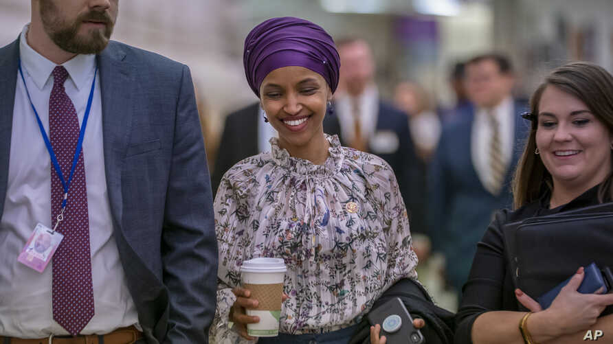 Rep. Ilhan Omar, D-Minn., walks through an underground tunnel at the Capitol as top House Democrats plan to offer a measure that condemns anti-Semitism in the wake of controversial remarks by the freshman congresswoman, in Washington, March 6, 2019.