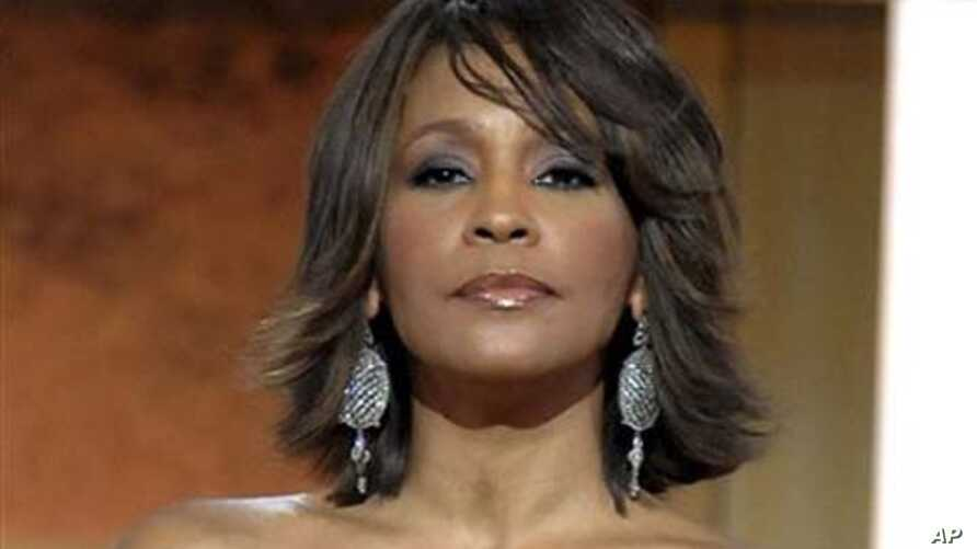 FILE - This Jan. 17, 2009 file photo shows singer Whitney Houston at the BET Honors in the Warner Theatre in Washington.  Houston died Saturday, Feb. 11, 2012, she was 48.  (AP Photo/Evan Agostini, File)