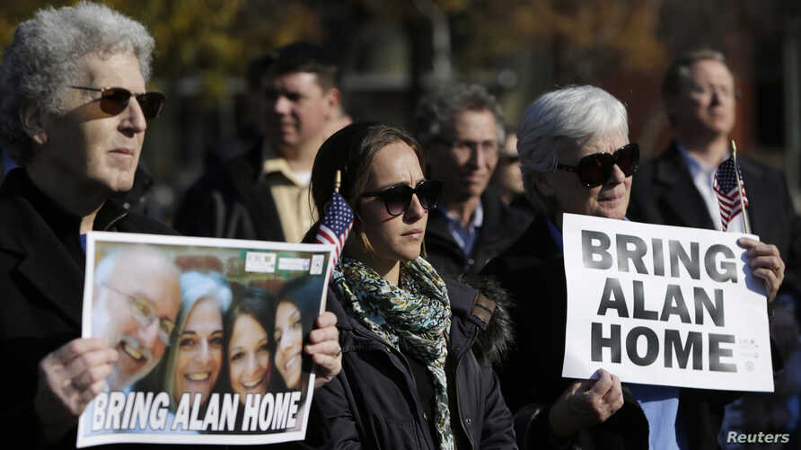 Demonstrators gather during a rally for U.S. detainee Alan Gross in Lafayette Square in Washington, Dec. 3, 2013.