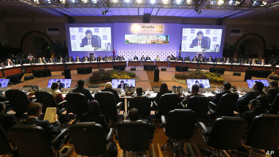 FILE -Board of Governors of the Asian Development Bank, Asia's premier lending institution, attend the final business session of the 51st ADB annual governor's meeting, May 5, 2018 in suburban Mandaluyong city, northeast of Manila, Philippines.