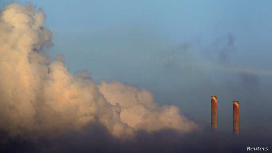 FILE - Vapor rises from Liddell Power Station near Muswellbrook, 170 km (106 miles) north of Sydney, Nov. 2, 2011.