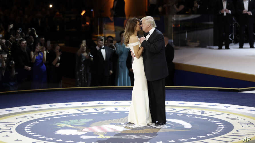 President Donald J. Trump dances with first lady Melania Trump at The Salute To Our Armed Services Inaugural Ball, Jan. 20, 2017, in Washington.