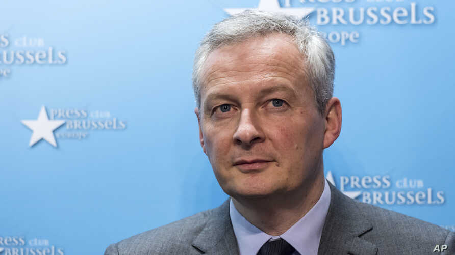 FILE - France's Finance and Economy Minister Bruno Le Maire speaks during a media conference regarding steel tariffs in Brussels on March 12, 2018.