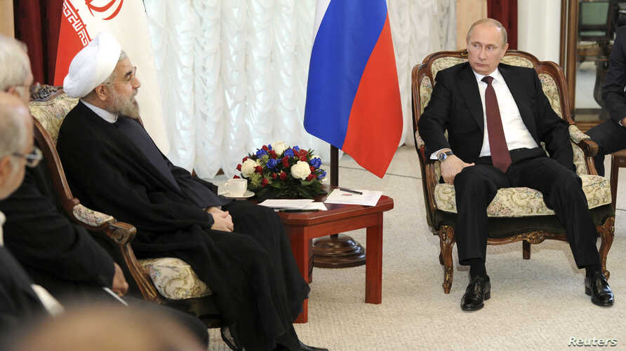 FILE - Russia's President Vladimir Putin (R) is seen meeting with his Iranian counterpart Hassan Rouhani during last year's Shanghai Cooperation Organization (SCO) summit in Bishkek, Kyrgyzstan, Sept. 13, 2013.