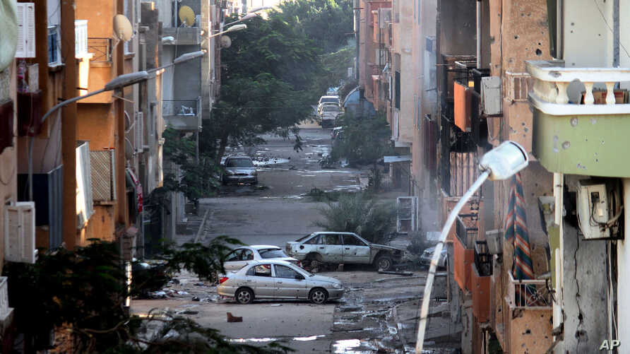 FILE - Damage is seen after clashes between the Libyan military and Islamic militias in Benghazi, Libya, Oct. 29, 2014.