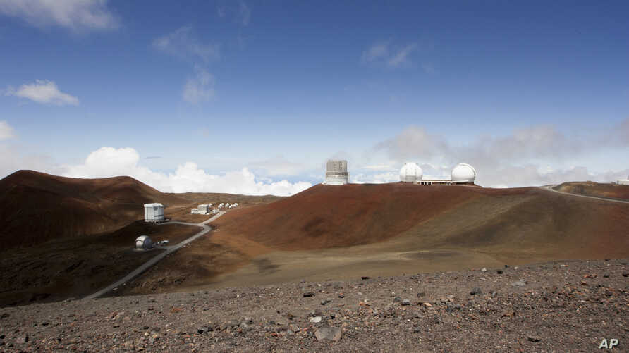 FILE - Telescopes rest on the summit of Mauna Kea on Hawaii's Big Island, Aug. 31, 2015. A hearings officer is recommending that a construction permit be granted for a giant telescope planned for the summit.