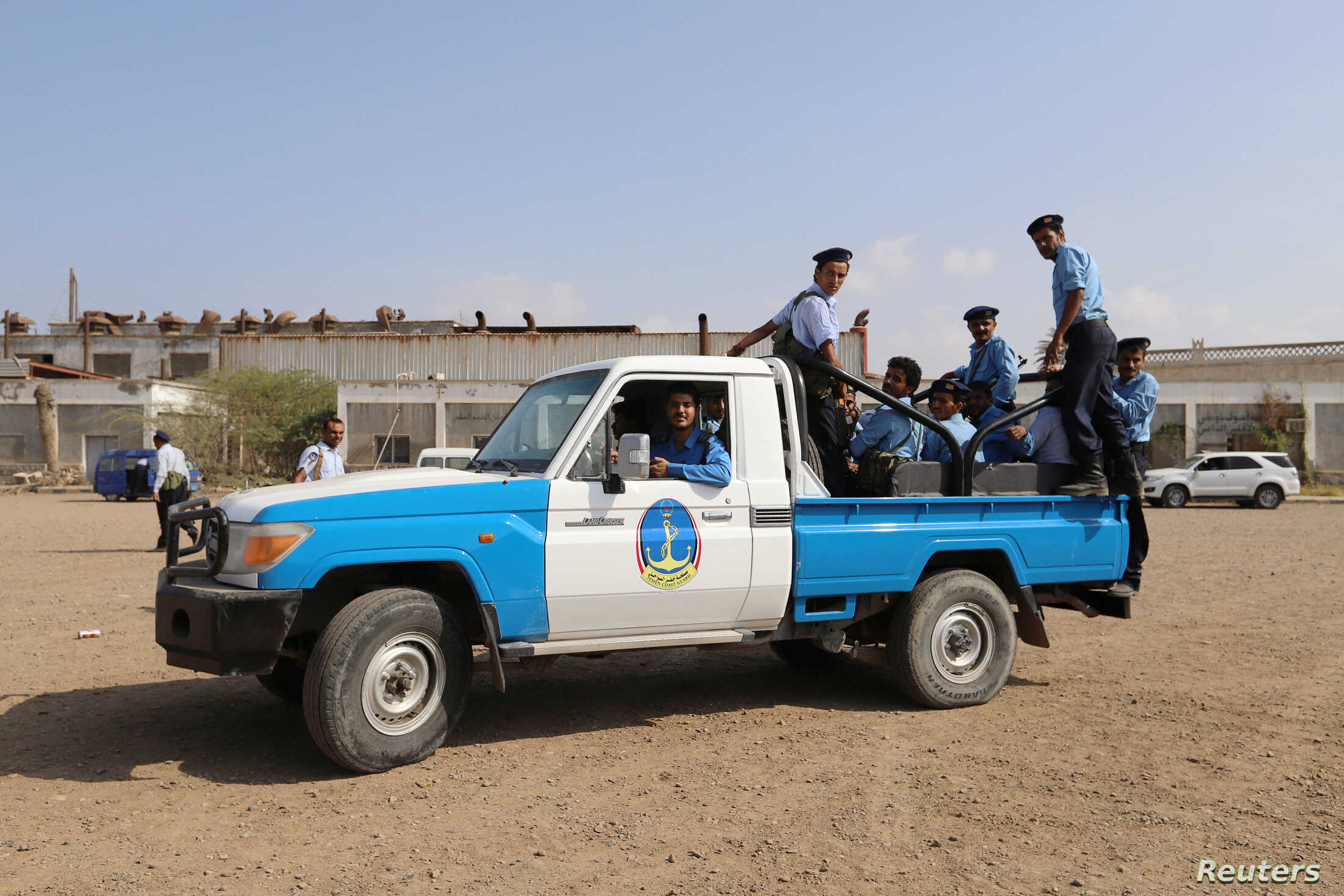 Members of a Yemeni coast guard force ride on the back of a petrol truck during their deployment as part of a U.N.-sponsored peace agreement signed in Sweden earlier this month, at the Red Sea city of Hodeidah, Yemen December 29, 2018.