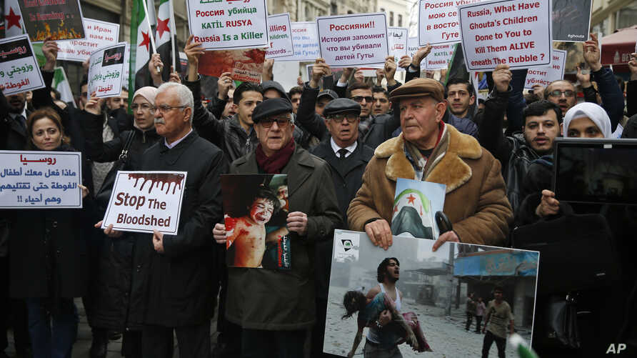 Syrians, including prominent opposition figures, protesting attacks on rebel-held suburb of eastern Ghouta in Syria's capital Damascus, gather during a rally outside the Russian Consulate in Istanbul, Thursday, Feb. 22, 2018.