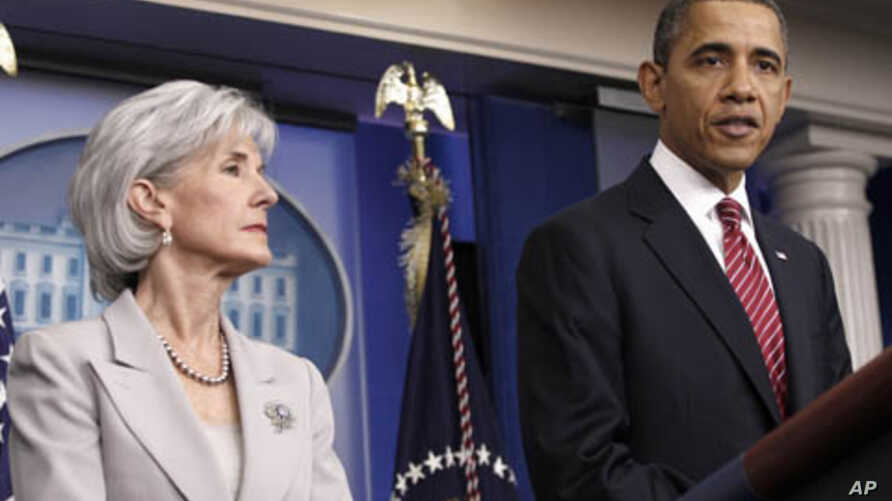 President Barack Obama, accompanied by Health and Human Services Secretary Kathleen Sebelius, announces the revamp of his contraception policy requiring religious institutions to fully pay for birth control, Feb. 10, 2012 at the White House.