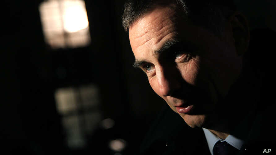 Corsica executive council head Gilles Simeoni answers reporters' questions after a meeting with France's then-prime minister, Manuel Valls, at the Hotel Matignon, in Paris, Jan. 18, 2016.