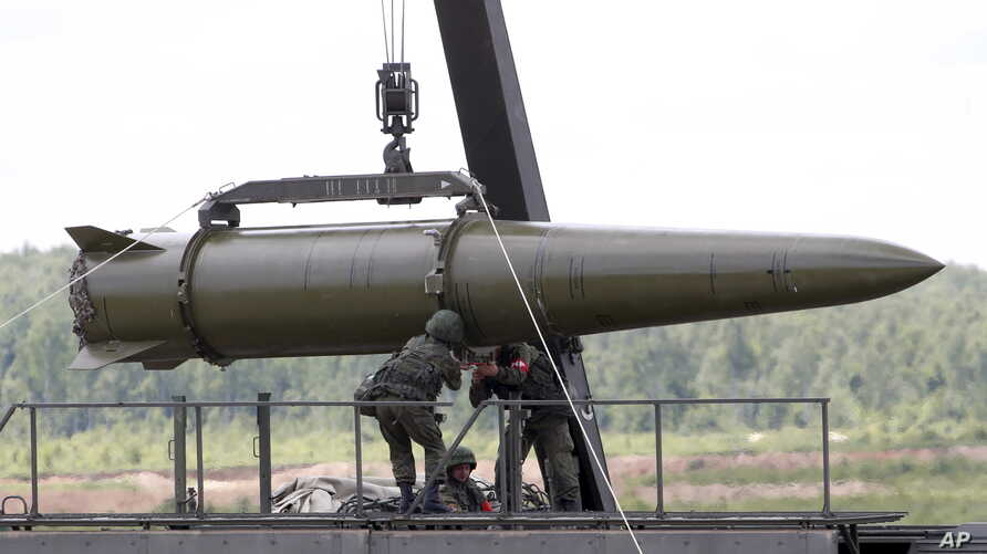 FILE - Russian servicemen equip an Iskander tactical missile system in Kubinka, outside Moscow, Russia, June 17, 2015.