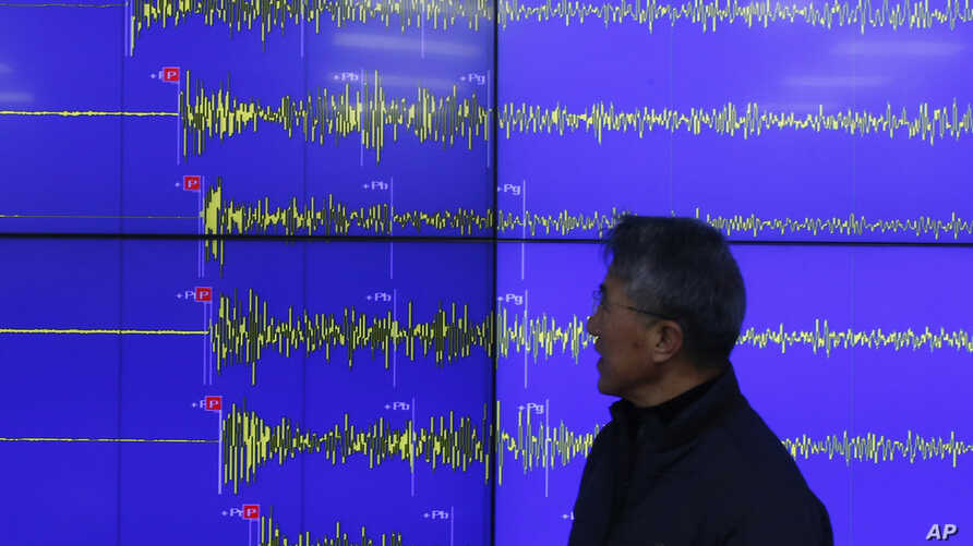 Yun Won-tae of the Korea Meteorological Administration stands in front of a screen showing seismic waves that were measured in Seoul after North Korea said it had conducted a powerful hydrogen bomb test, Dec. 6, 2015.