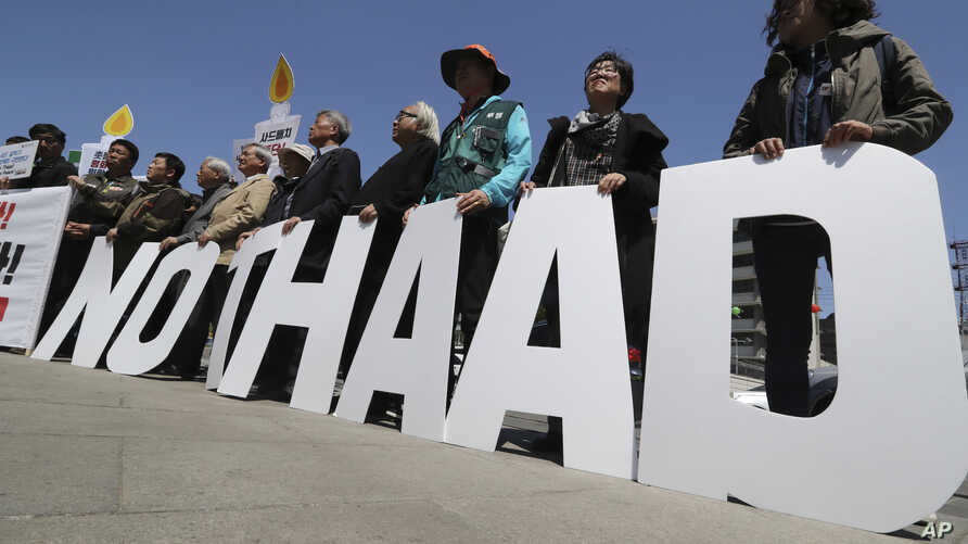 "Protesters hold letters reading ""NO THAAD"" during a rally to oppose a plan to deploy an advanced U.S. missile defense system called Terminal High-Altitude Area Defense, or THAAD, near U.S. Embassy in Seoul, South Korea, April 26, 2017."