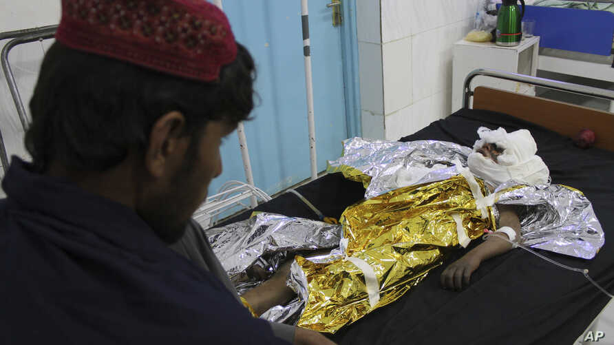 An injured boy receives treatment at a hospital after an airstrike in Helmand province, southern Afghanistan, Nov. 28, 2018.