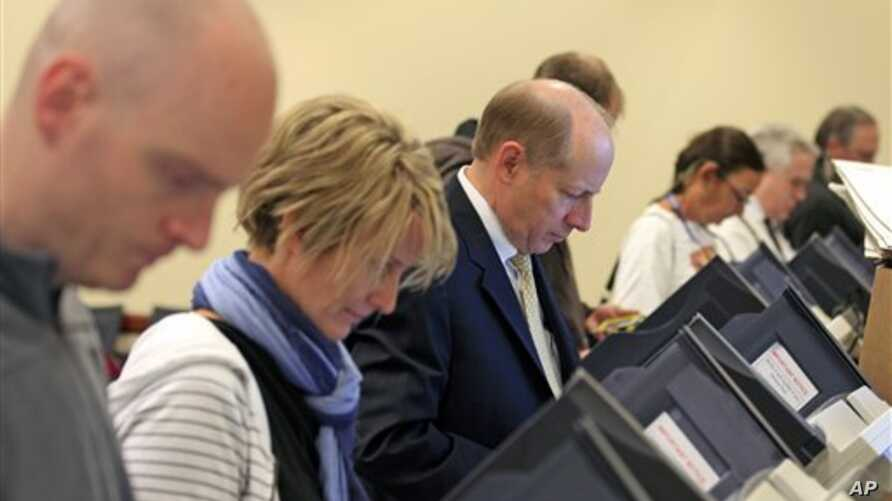 Voters at their voting machines at the Utah State Capitol Tuesday, Nov. 6, 2012, in Salt Lake City.