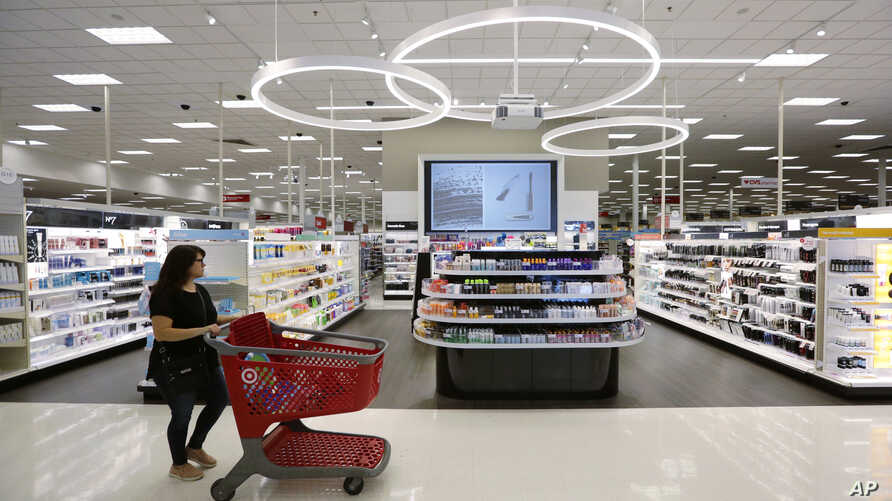 FILE- A shopper walks through the updated cosmetic department at a Target store in San Antonio, Texas.