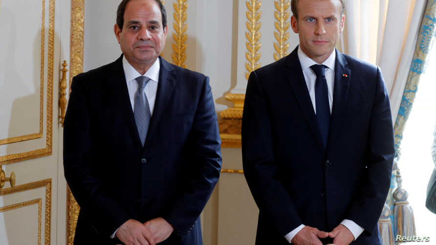 FILE - French President Emmanuel Macron and Egyptian President Abdel Fattah al-Sisi attend a news conference at the Elysee Palace, in Paris, Oct. 24, 2017.