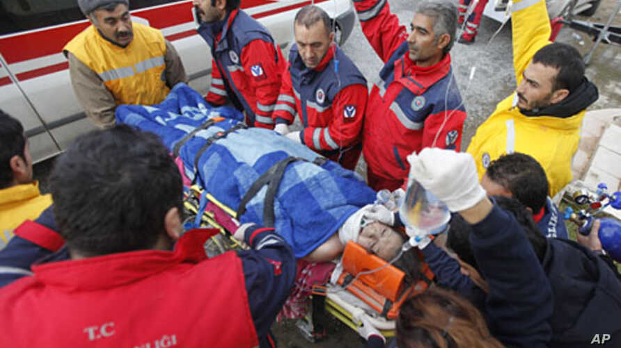 Twenty-seven year-old earthquake survivor Gozde Bahar is carried to an ambulance by rescue workers in Ercis, near the eastern Turkish city of Van, October 26, 2011.