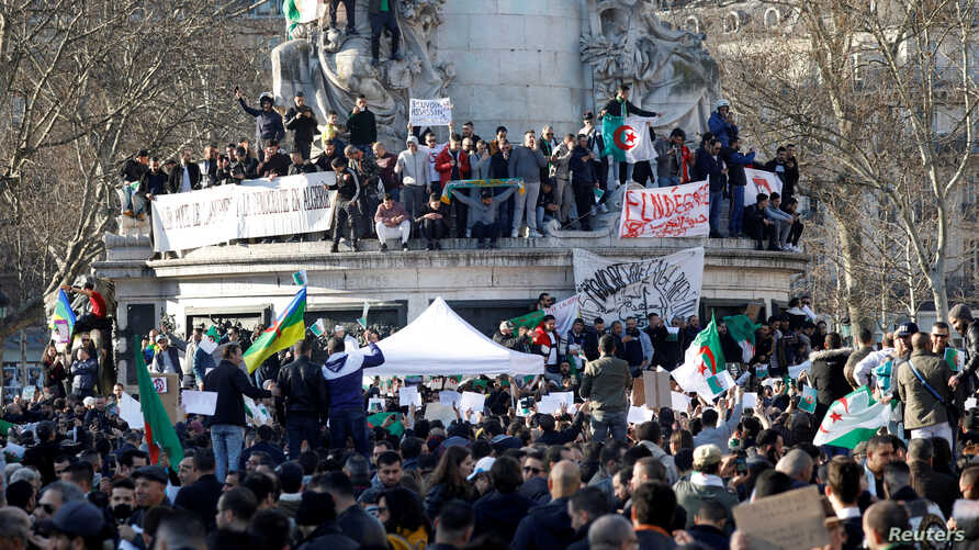 Demonstrators gather around the Monument to the Republic during a protest against President Abdelaziz Bouteflika seeking a fifth term in a presidential election set for April 18, in Paris, France, Feb. 14, 2019.