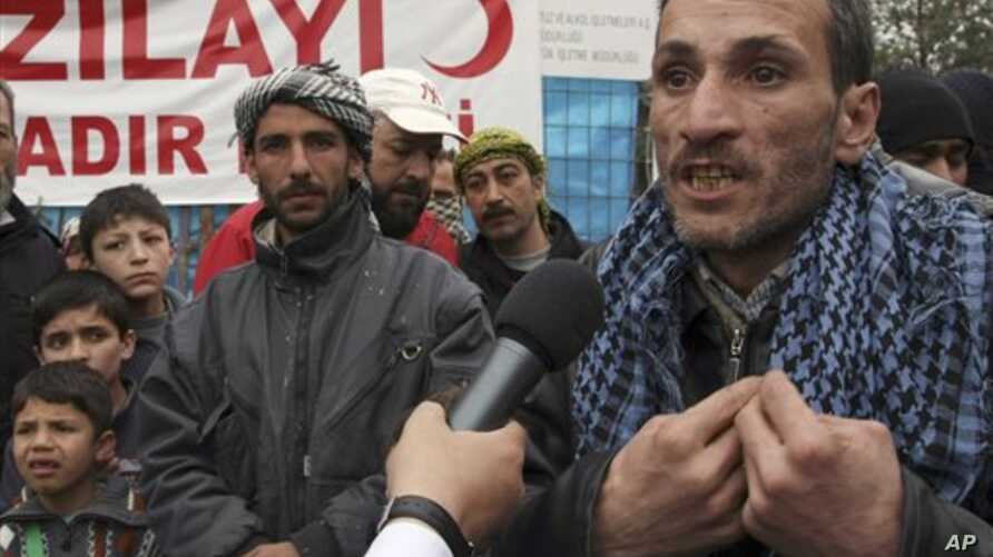Syrian refugee Nizar Hajyousuf speaks in Yayladagi, Turkey about about violence in his Syrian hometown, Jisr Ash Shugur, Mar 12, 2012.