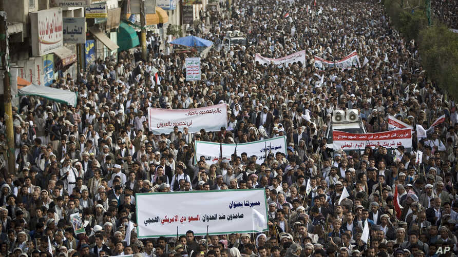 Shiite rebels, known as Houthis, gather during a protest against Saudi-led airstrikes in Sanaa, Yemen, Friday, April 10, 2015.