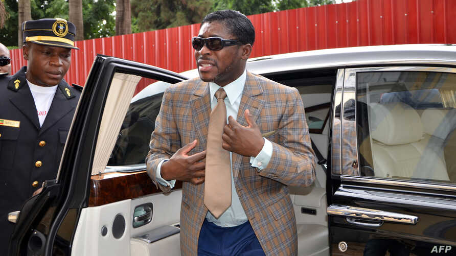 Teodorin Nguema Obiang (R), the son of Equatorial Guinea's president Teodoro Obiang and the country's vice-president in charge of security and defense, arrives at Malabo's Cathdral to celebrate his 41st birthday, June 25, 2013.