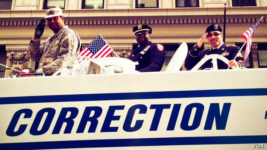 New York City Department of Corrections officers who are also proud military veterans had their own patriotic float in Monday's Veterans Day Parade up Fifth Avenue. (VOA/Adam Phillips)