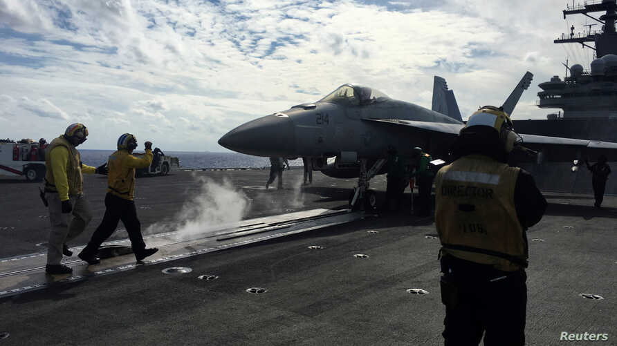 U.S. Navy aircraft carrier USS Ronald Reagan conducts military drills during Keen Sword, a joint field-training exercise involving U.S. military, Japan Maritime Self-Defense Force personnel and Royal Canadian Navy, Nov. 3, 2018.