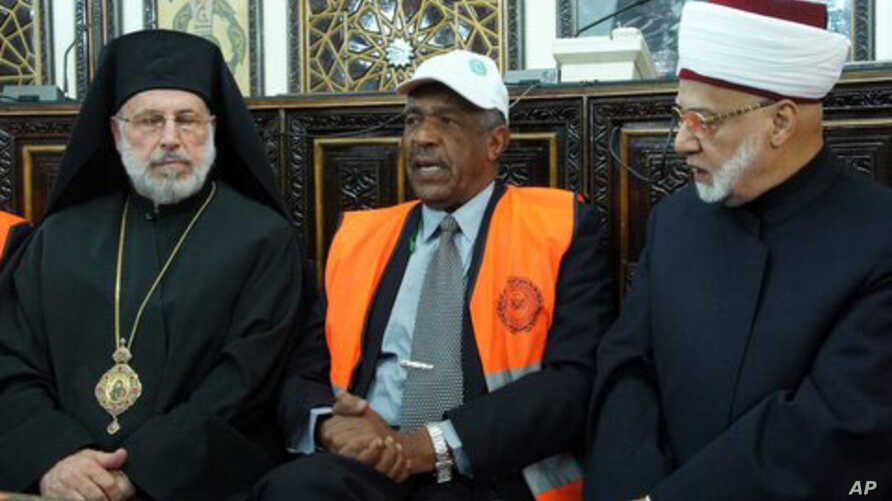 Arab League monitors meet with religious leaders in Damascus Jan. 17, 2012