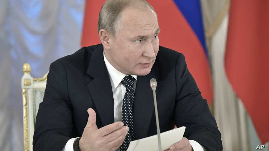 Russian President Vladimir Putin speaks at meeting with cultural advisers in St. Petersburg, Russia, Dec. 15, 2018. Alarmed by the growing popularity of rap among Russian youth, Putin wants cultural leaders to devise a means of controlling popular mu