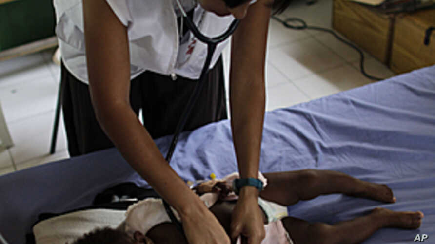 Maria Jose Caceres, a nurse for the relief organization Doctors Without Borders (MSF), listens to the chest of a child with pneumonia, at an emergency hospital run by MSF in Port-au-Prince, Haiti, May 12, 2011.