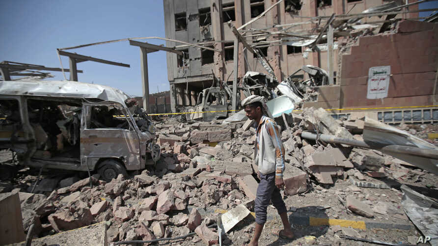 A man inspects rubble after a Saudi-led coalition airstrike in Sanaa, Yemen, Feb. 4, 2018.